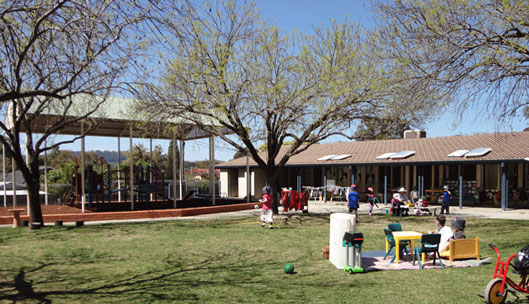 Children playing in the palyground at Torrens Preschool