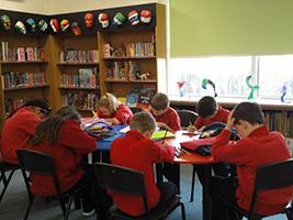 Children working in library